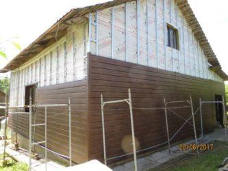 Обшивка дома металлическим сайдингом с утеплителем